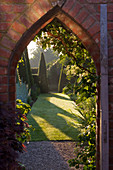 WOLLERTON Old HALL, SHROPSHIRE: GATEWAY INTO THE YEW WALK. VISTA. VIEW. SHADOW