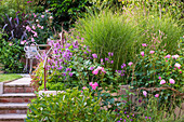 BARBARA KENNINGTON Garden, BRIGHTON: BORDER with ROSES AND GRASSES AND STEPS with RAILINGS
