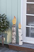 Selbstgemachte Kerzen aus Birkenstaemmen als weihnachtliche Deko