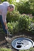 Wasserspiel mit Frosch auf Granit-Säule aufbauen