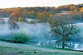 GRAVETYE MANOR, Sussex: Mist Rises Off THE Lake IN SPRING