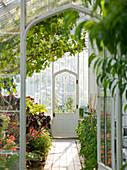 Arundel Castle GARDENS, West Sussex: THE Collector Earls Garden; THE INTERIOR of THE Greenhouse - VIEW THROUGH THE DOOR TO THE DOOR BEYOND - Framing
