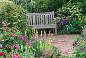 A PLACE TO SIT: Cottage STYLE PLANTING SURROUNDS SEAT On BRICK TERRACE IN THE SPOUT Garden, CHELSEA 97. Designer: Roger PLATTS