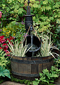 HALF BARREL with Water PUMP AND BUCKET with VARIEGATED Iris LEAVES. CHELSEA 95