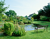 SEAT Beside LILY POND at GREENHURST Garden, Sussex