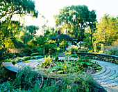 VIEW of KITCHEN TERRACE LILY Pool IN all ITS SUMPTUOUS Detail - LOTUS, Canna AND Water LETTUCE. Designer: James Van SWEDEN. AMERICA
