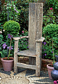 A PLACE TO SIT: WOODEN CHAIR STANDING On PEBBLE SUNFLOWER MOSAIC, Capel MANOR GARDEN. CHELSEA FLOWER Show