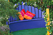 THE SAUK EREISMA Garden, HAMPTON Court 2003, DESIGNED by STEPHANIE WILLCOX: Blue WOODEN SEAT with CUSHIONS
