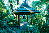 THE JAPANESE BELL TOWER IN THE WOODLAND. DESIGNERS: ILGA JANSONS AND MIKE DRYFOOS, Seattle, USA