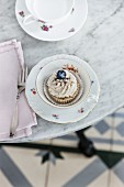 Vegan poppy seed cupcake with lemon frosting