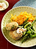 Lentil meatballs with carrot noodles, asparagus and lime cream
