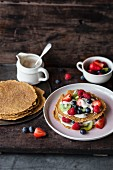 Coconut and courgette pancakes with fruits and vanilla cream