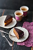 Slices of vegan Sacher cake with apricot filling