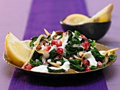 Spinach salad with pomegranate kernels and almonds (Morocco)