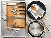 Kitchen utensils for making snapper adobo with a pepper ragout
