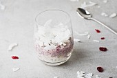 Rice pudding with cranberries and coconut in a glass