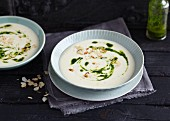 Creamy parsnip soup with almond flakes and parsley oil