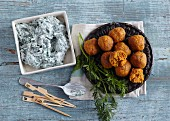 Vegetarian carrot balls with a spinach dip
