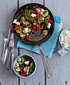 Vegetarian potato and vegetable pan-served dish with feta