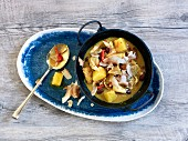 Caribbean chicken curry with pineapple and coconut chips