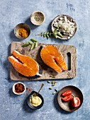 Ingredients for grilled salmon steaks in a tomato and curry sauce