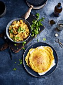 Potato and cauliflower curry with bean pancakes (India)