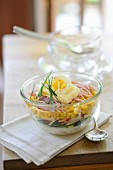 Layered salad with ham, corn, mayonnaise and egg