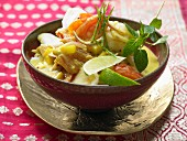Fish and coconut curry with mango, tomatoes and aromatic spices