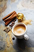 Cup of espresso with spices and Christmas decorations