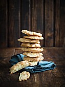 Small savory paleo flourless gluten free breads, arranged in a pile