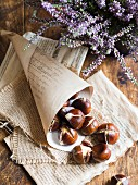 Roasted chestnuts on a rustic background