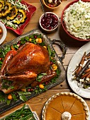 Thanksgiving dinner with turkey, side dishes and pumpkin pie (USA)