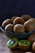 Kiwis in and next to a fruit bowl