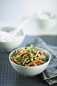 Stir-fried Chicken with Snow Peas and Walnuts