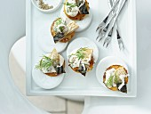 Potato crostini with horseradish and smoked mackerel