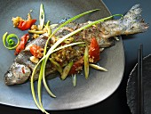 Szechuan trout with tomatoes and chili