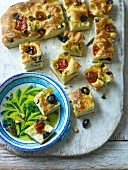 Focaccia with preserved tomatoes,olives and thyme