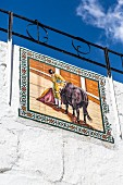 A tiled mural on the wall of the bullring in Mijas Pueblo, Andalusia, Spain