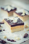 Coconut and caramel cake slices with chocolate