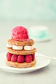 A pancake tart with raspberries and raspberry sorbet