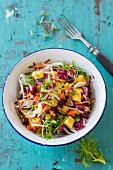 A vegetable salad with a mango and ginger dressing