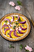 A courgette tart with red onions