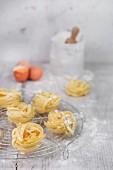 Homemade fettuccine, eggs and flour