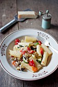 Rigatoni ortolana. Pasta with vegetables (zucchini, eggplant, red pepper, carrot, tomatoes, garlic and onion). Served with grated parmesan cheese and freshly ground black pepper