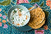 Vegetarian aubergine raita with chilli served with poppadoms (India)