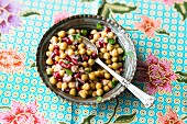 Vegan chickpea salad with pomegranate seeds and coriander (India)