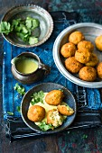 Vegetable paneer balls with a yoghurt and curry sauce (India)