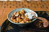 Chicken in cashew sauce with rice (Kashmir, India)