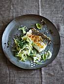 Skrei cod fillet with lardo on a bed of fennel with wakame (low carb)