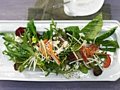 Mixed salad with vegetable strips and sheep's cheese